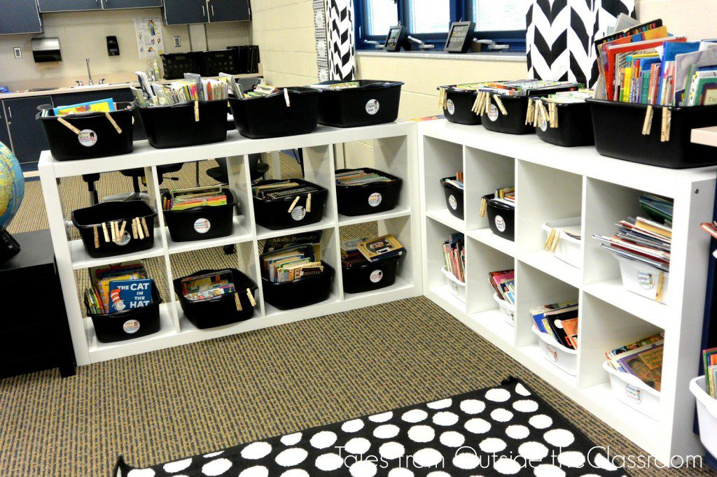 The Books Are Organized Into Black And White Bins For Fiction Non