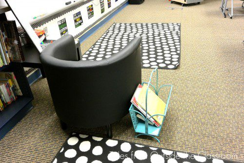 Black and white rug and black classroom chair