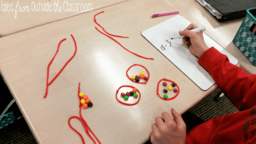 Introduce division using Skittles and Twizzlers